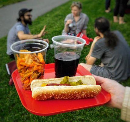 Hotdog, soft drink, chips