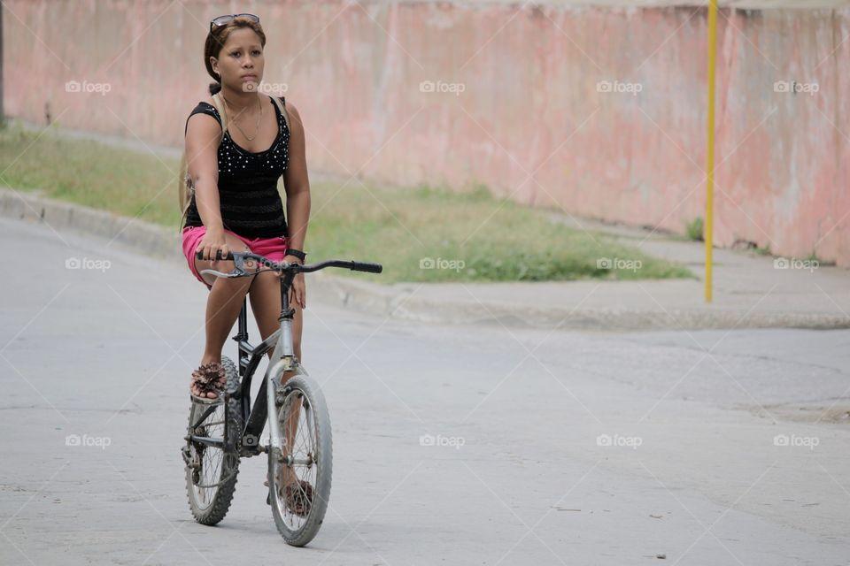 People In Cuba.Girl On Bike