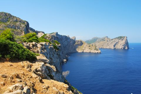 View of blue sea by cliffs