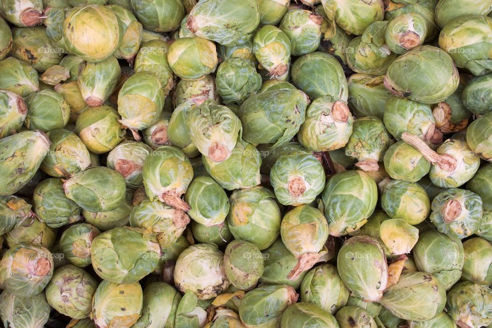 Many  Brussels sprouts at an outside fruit and vegetable market in Brooklyn, New York City,