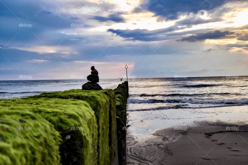 Breakwater on the North Sea beach. On a stormy day in the summer of 2019 on the island of Sylt