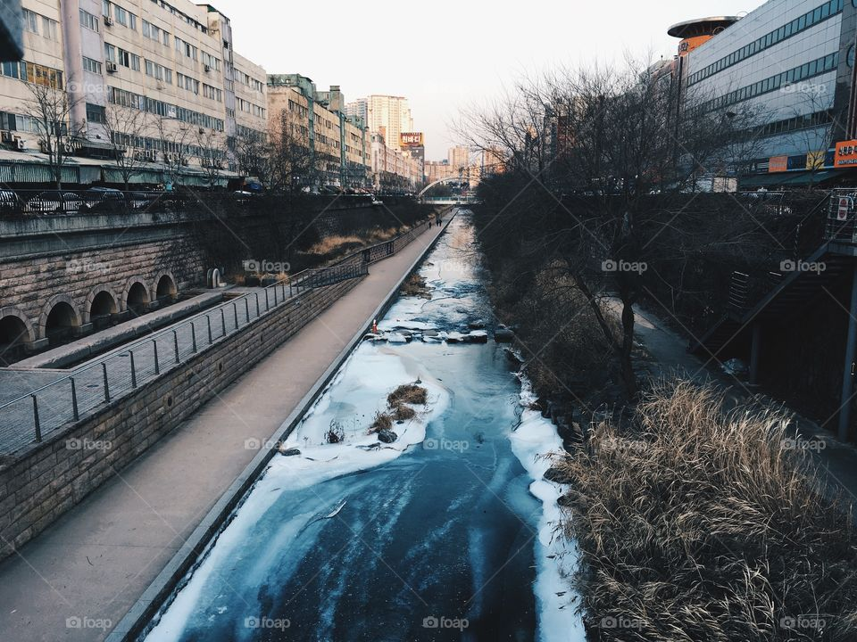 Small stream flowing in city