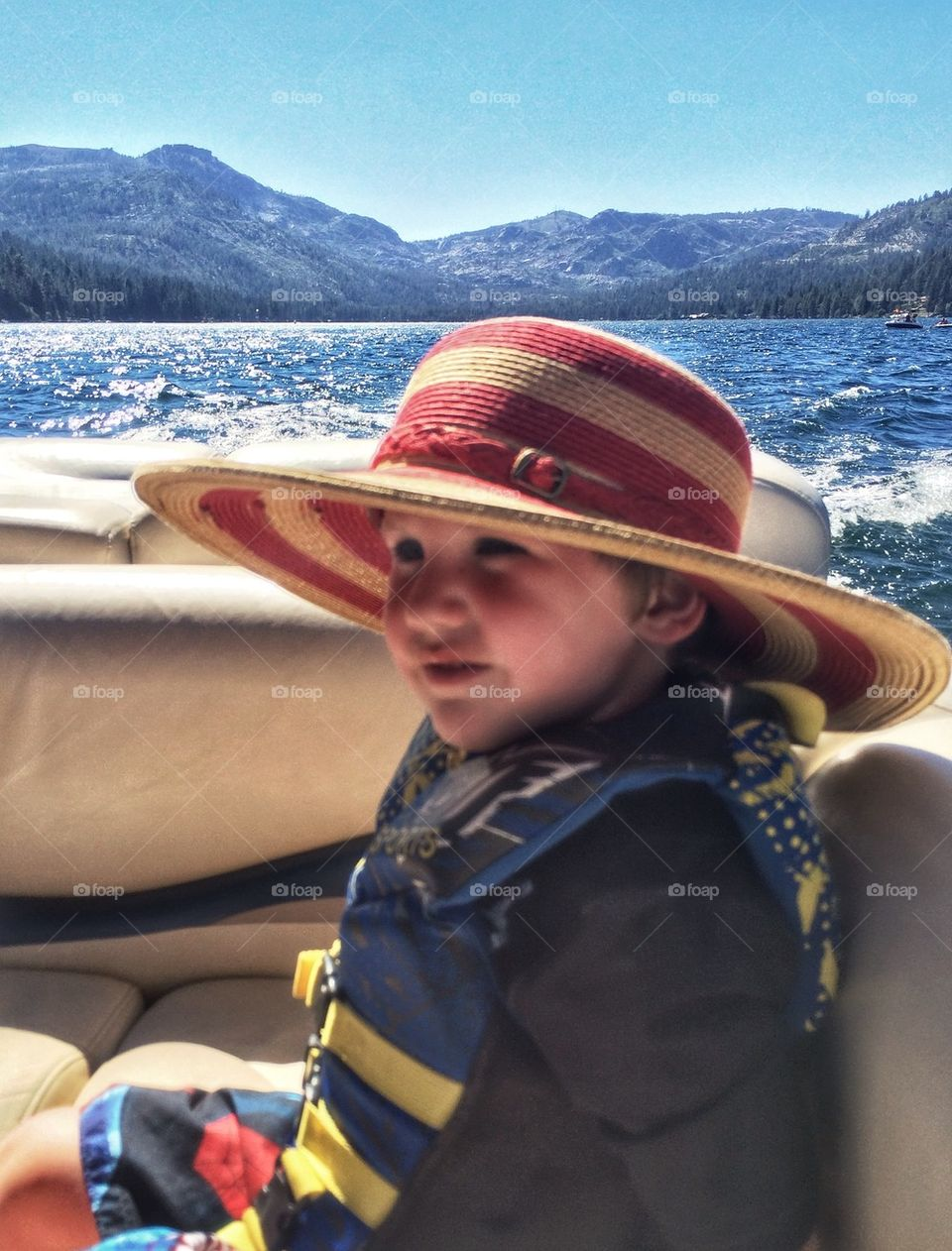 Young Boy Wearing A Hat In The Sun