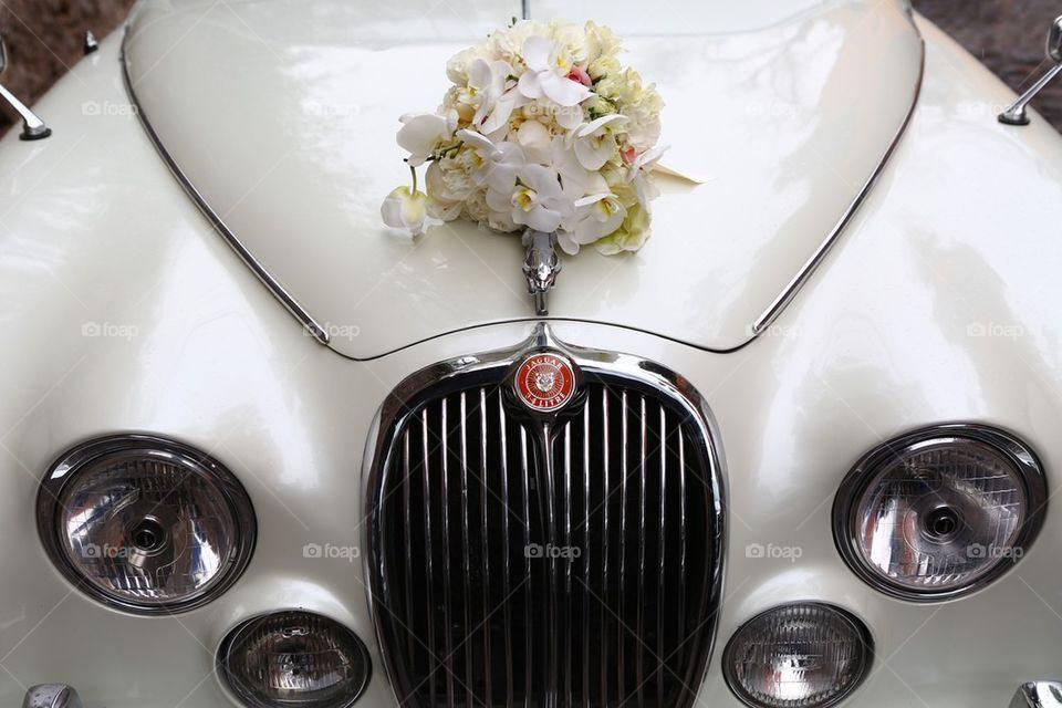 Vintage jaguar limo and flowers