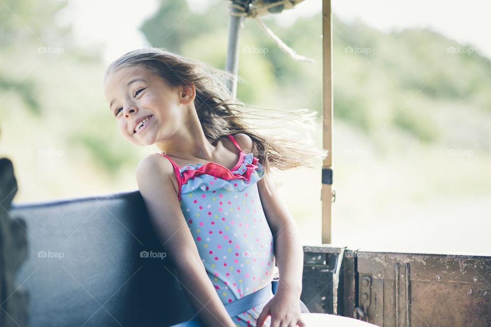 Happy little girl enjoying in park