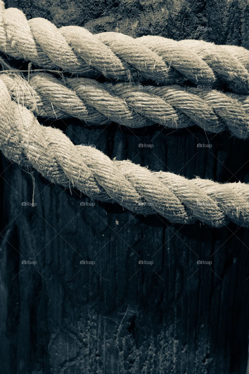 Monochromatic Rope Wrapped Around A Wooden Pier
