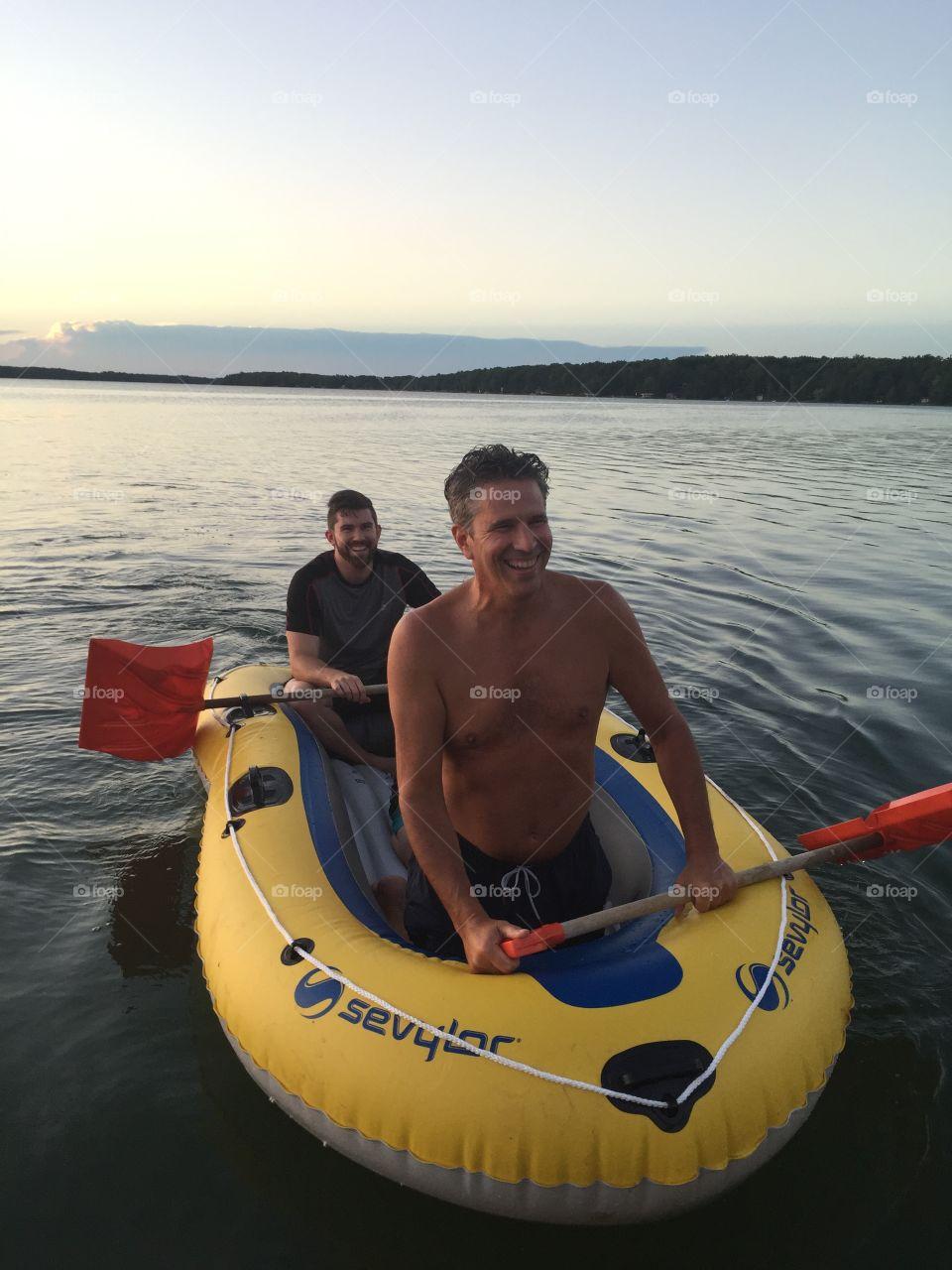 Male friends enjoying kayaking