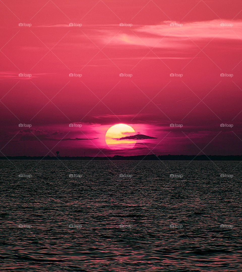 Sunrises, sunsets and the moon - The mauve dusky sky intensified, and in just a while, the biggest star had set, the sun -  I found myself looking at a lustrous, argent disc casting brilliant rays of sun onto the dark ocean below