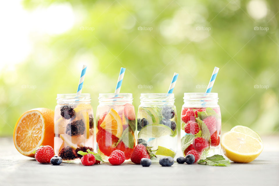 Colorful summer water drink with berries