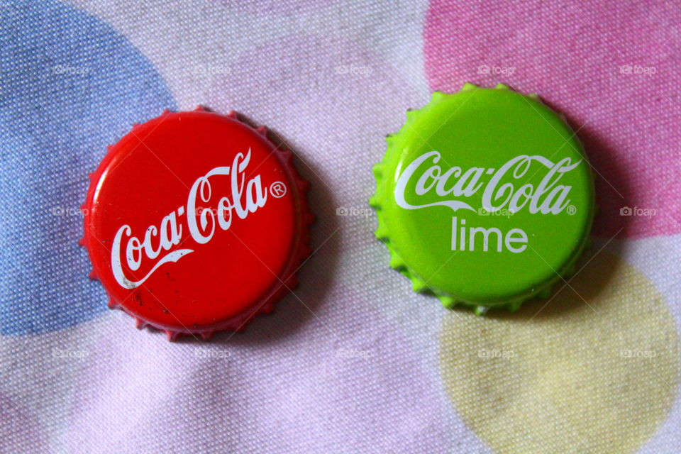 Coca cola green and red caps