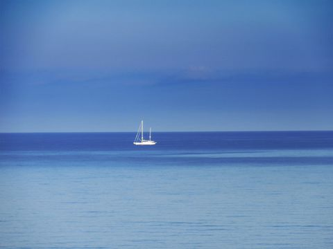 Sailboat in the sea of Cape D'Arena ( Palinuro - Italy ).