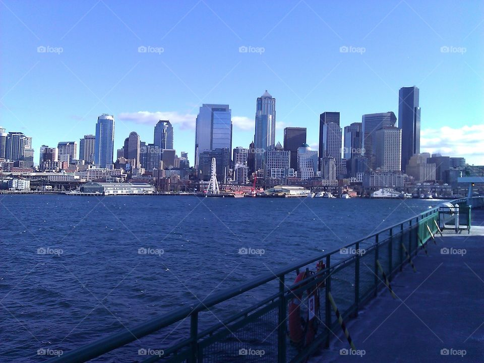 Seattle Skyline From Ferry. A view of the Seattle skyline taken from a ferry traveling across puget sound.
