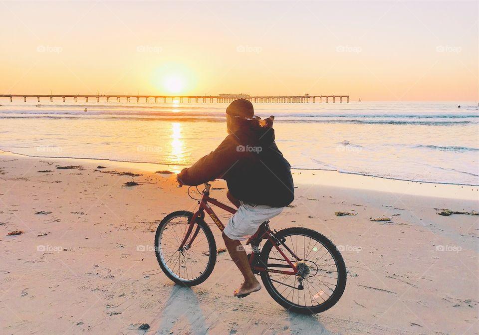 Riding a bike at sunset