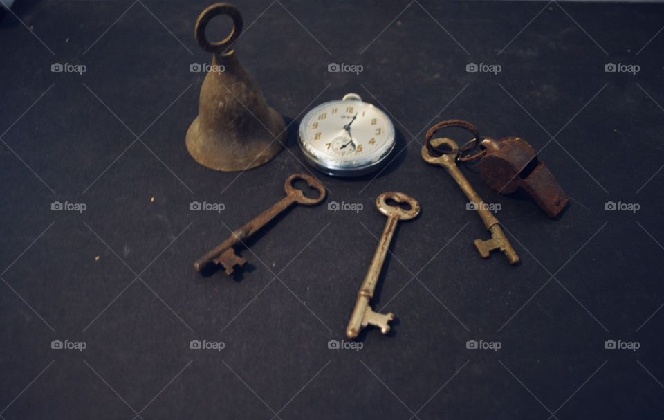 Antique things I have saved. Skeleton keys,bell,watch