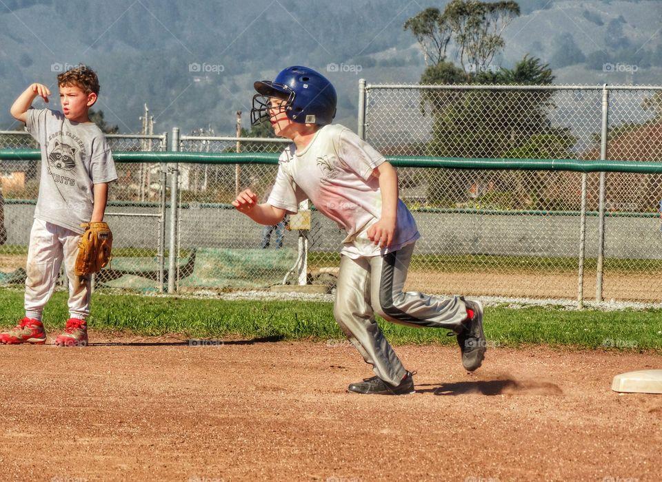 Love Running. Young Baseball Runner
