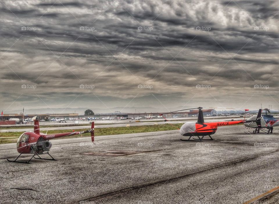 Helicopters On The Flightline. Robinson R-22 And R-44 Helicopters On The Flightline