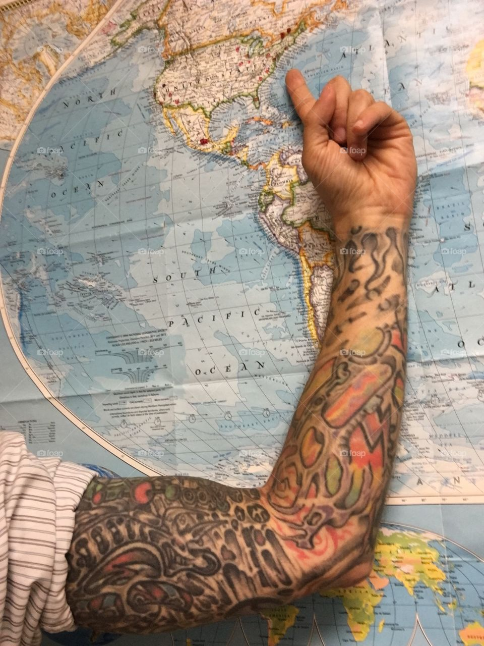 Pointing to my home Troy, Ny on a world map.
