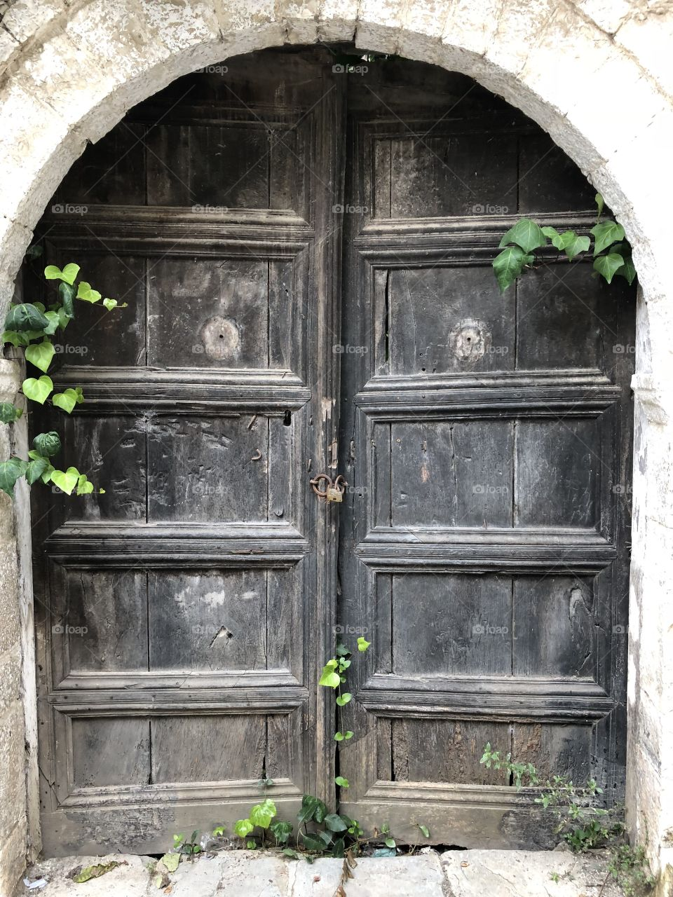 An old door in an narrow alley of the old town Berat in Albania.