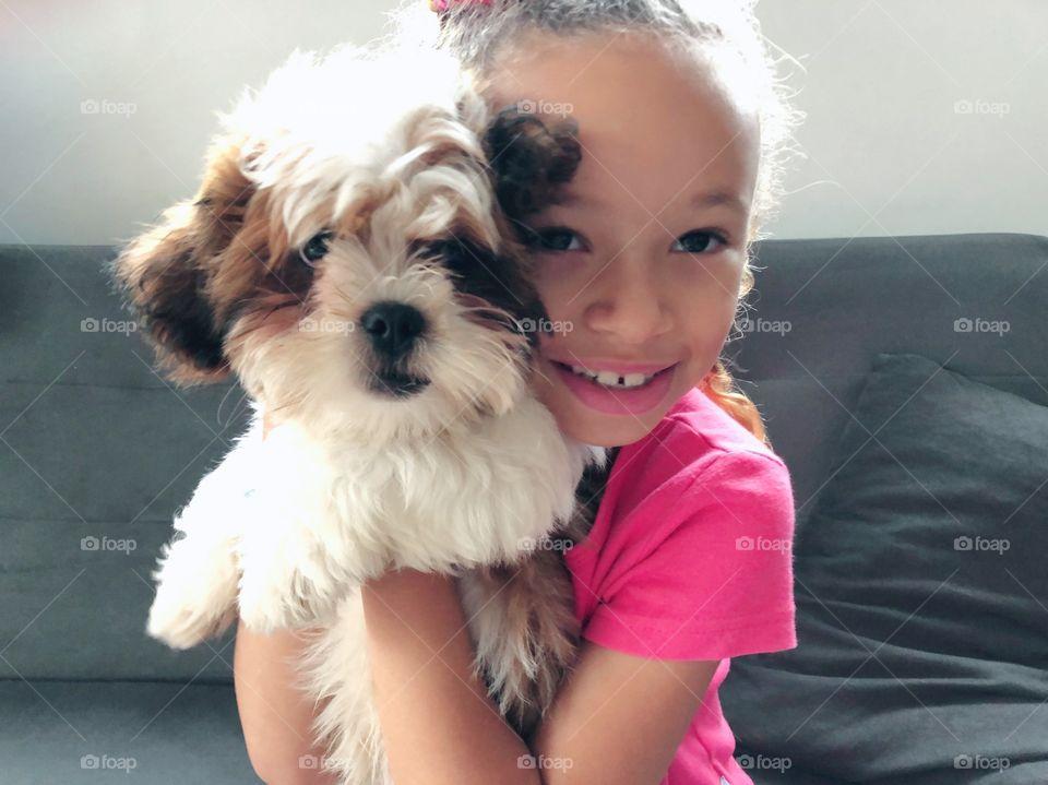 Little girl holding a puppy