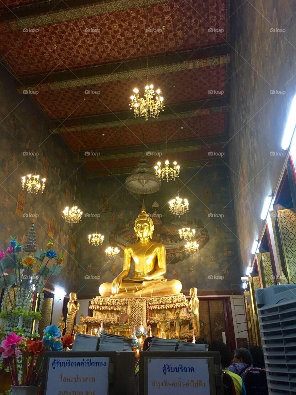 Praying with Buddha in Bangkok.