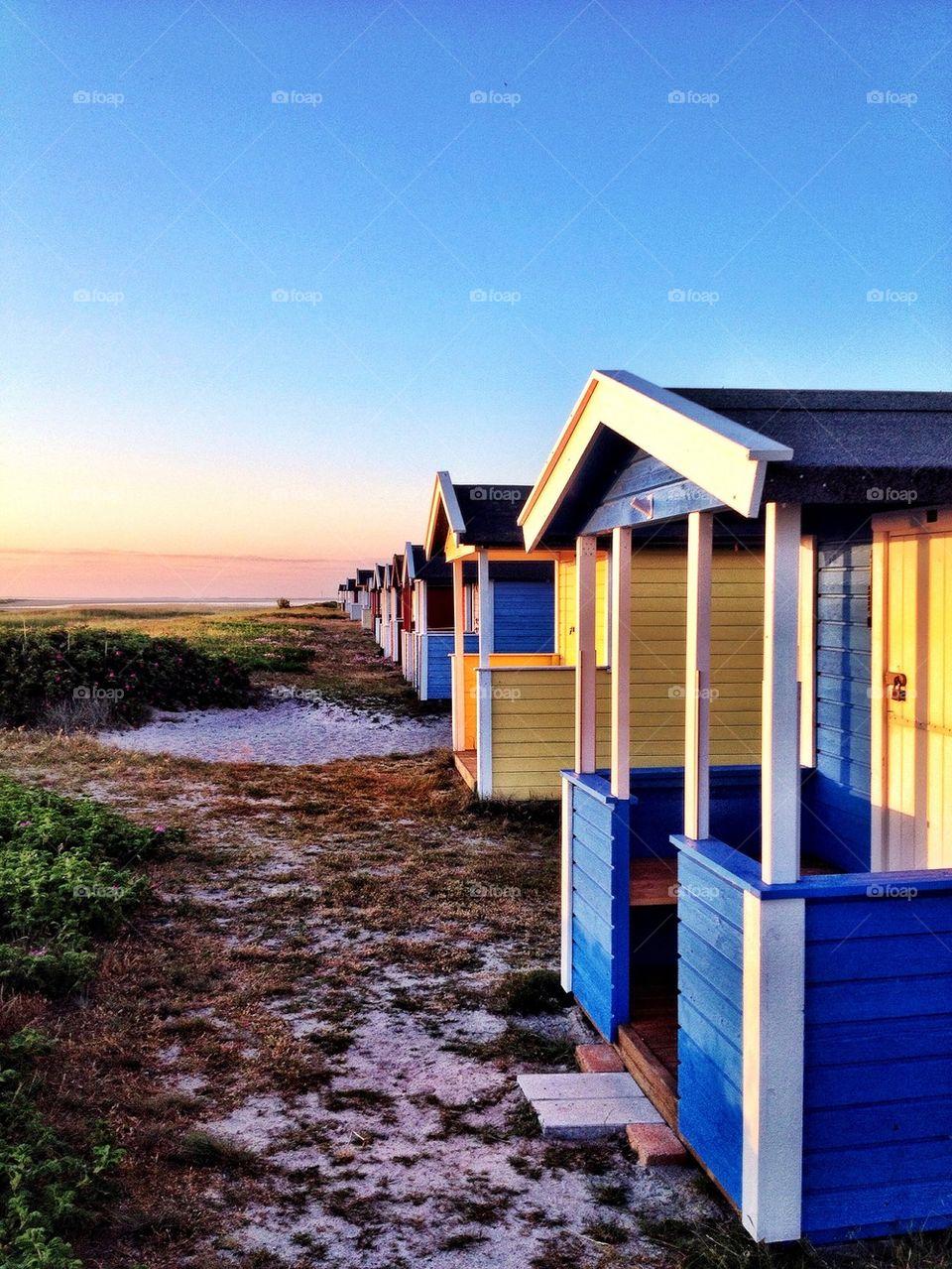 Beach huts in sunset
