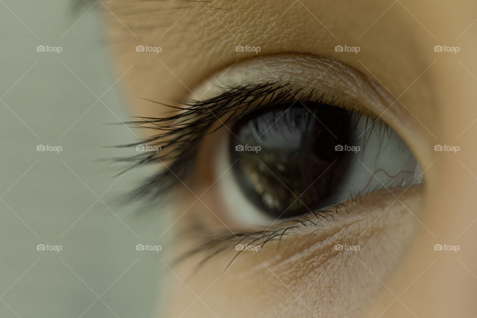 Macro close eyes of Asian kid's. Natural deep dark color iris.