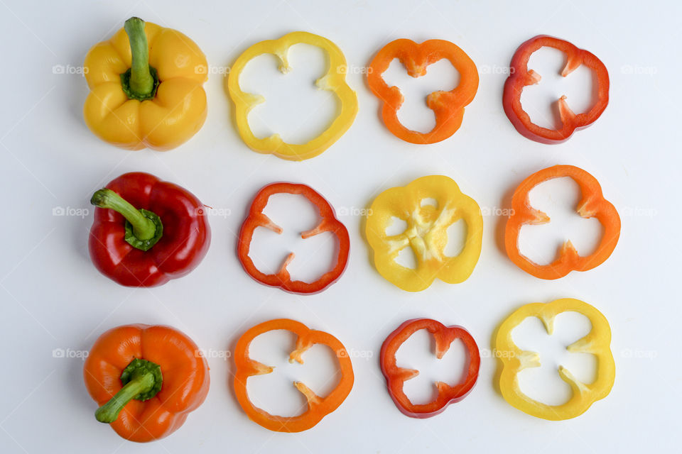 Sweet peppers in rows and slices