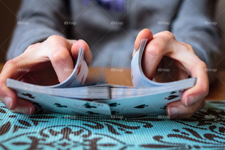 A person shuffling cards