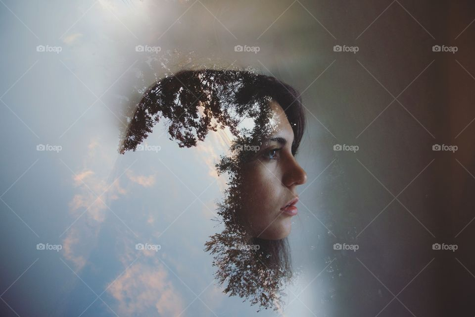 Double exposure. Taken from my backyard, my own face used