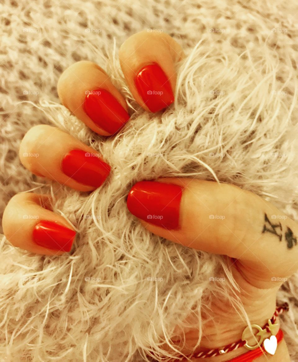Red nails. Manicure. Finger tattoo