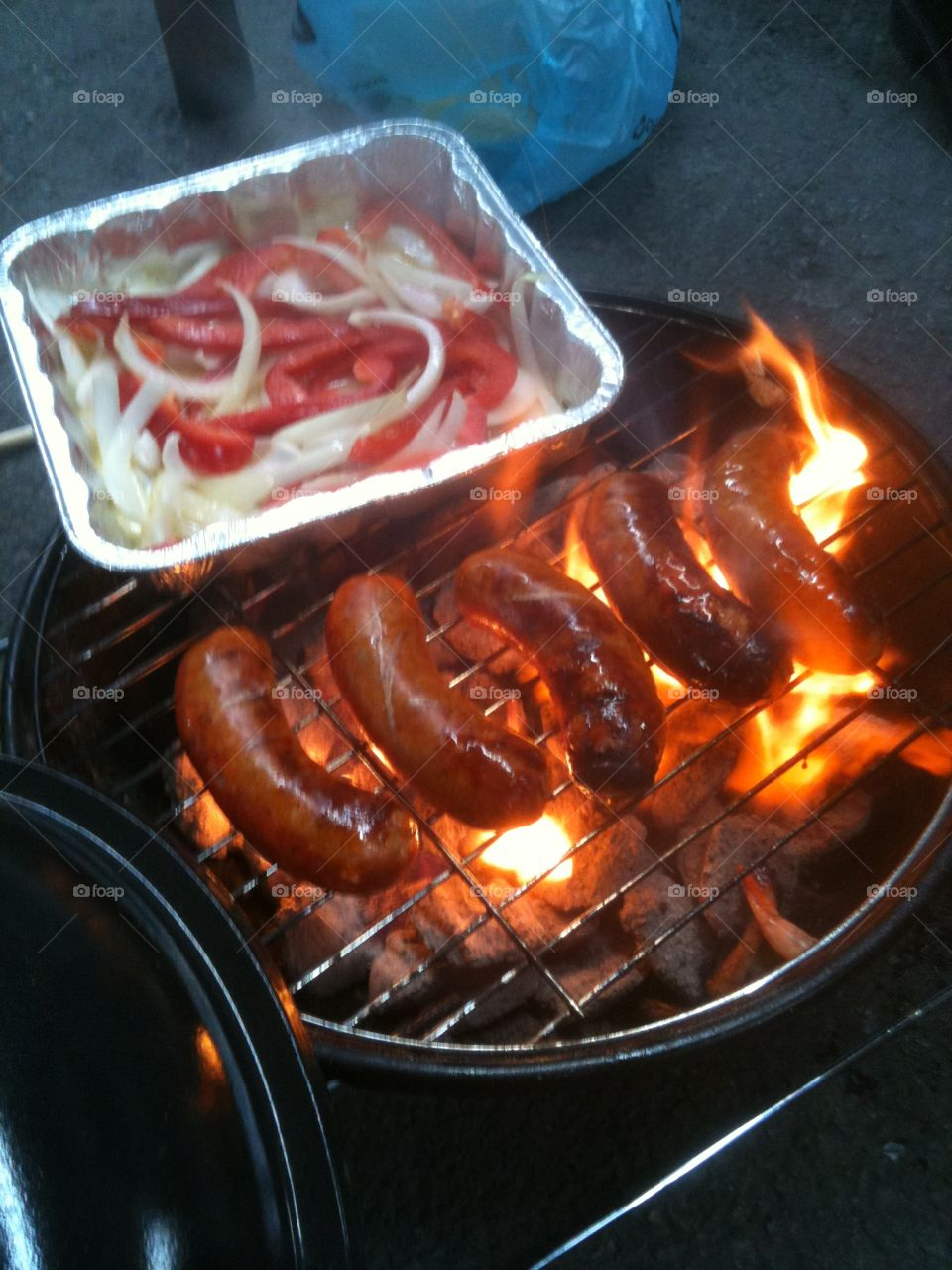 Tailgating at the Steelers game. Cooking Italian sausages, peppers and onions on the grill.