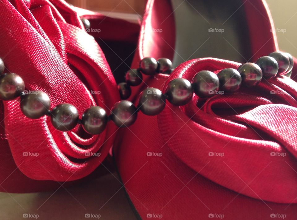 Pearls and heels. Black pearls and red high heels