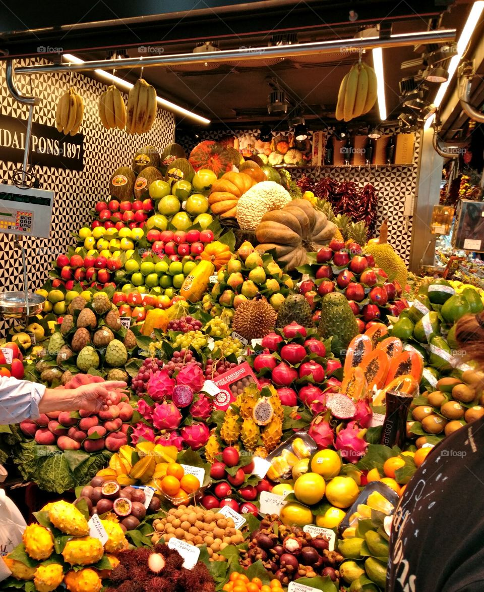 Colorful merchandise displayed in one of the La Boqueria's greengrocers in Barcelona