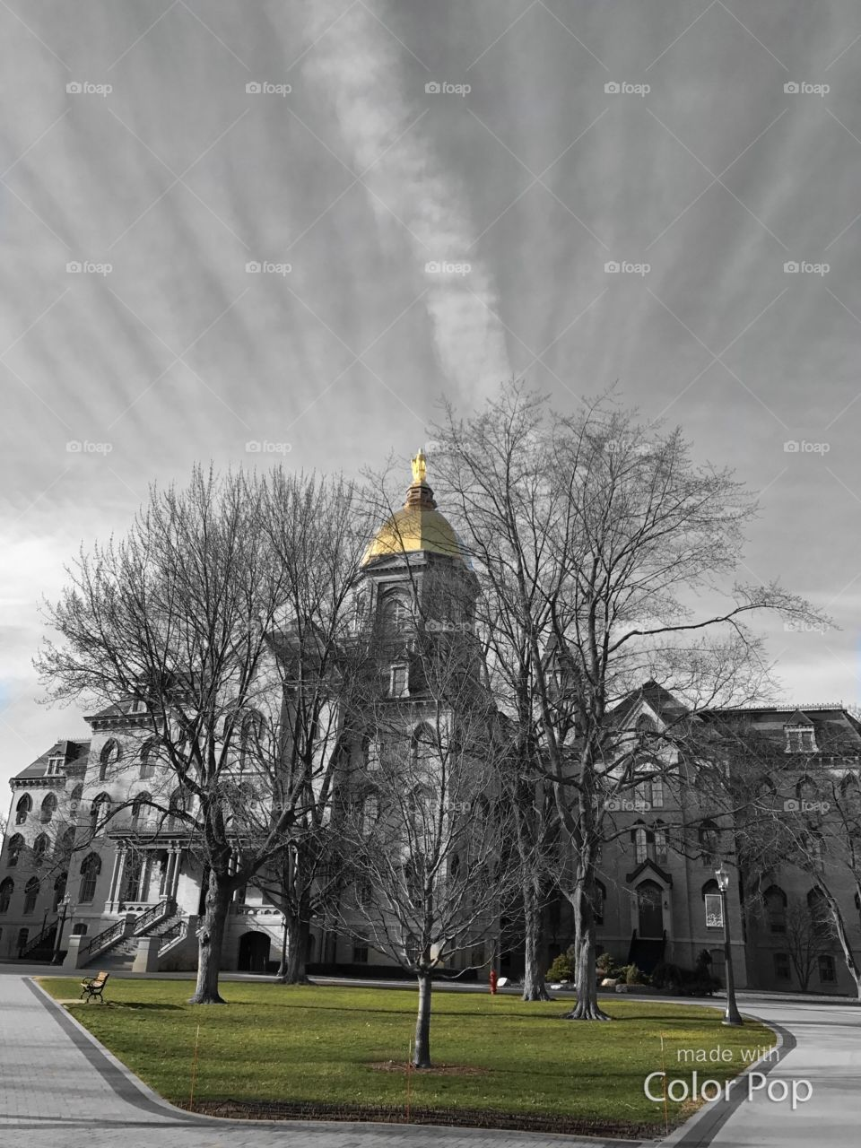 Black and white with color pop of admin building at ND