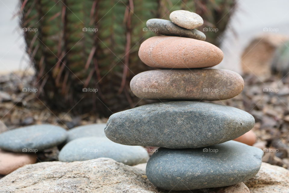Stacked stones on rough rock