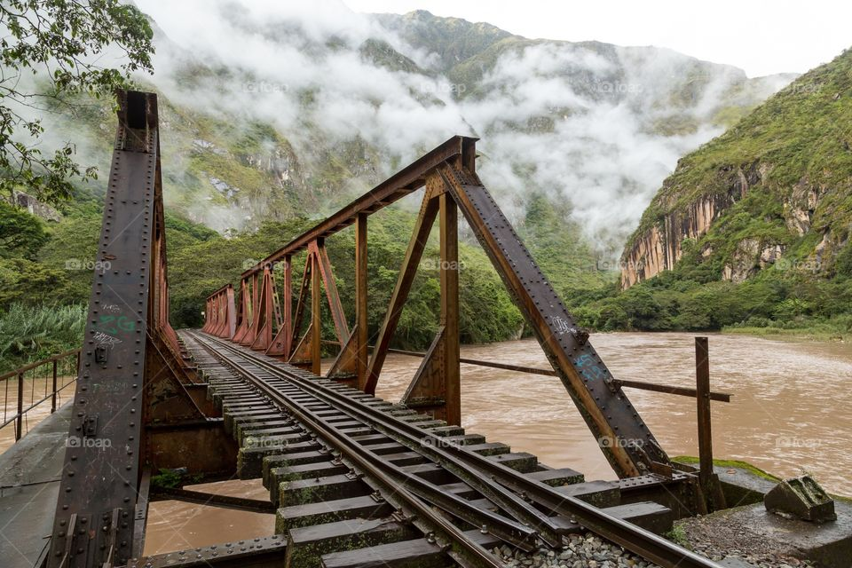 Old rusty railroad against mountain