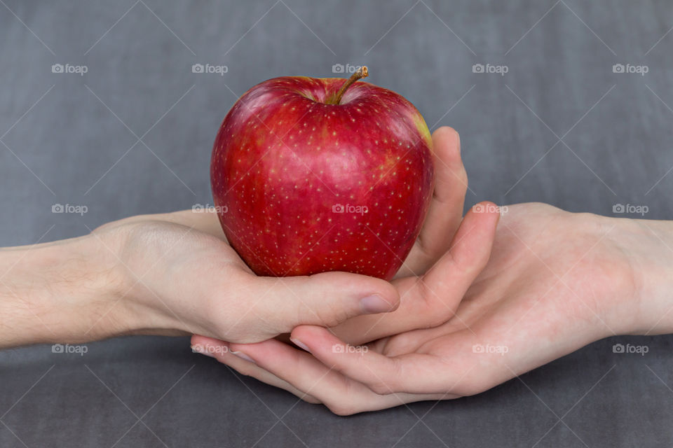 red Apple in hands