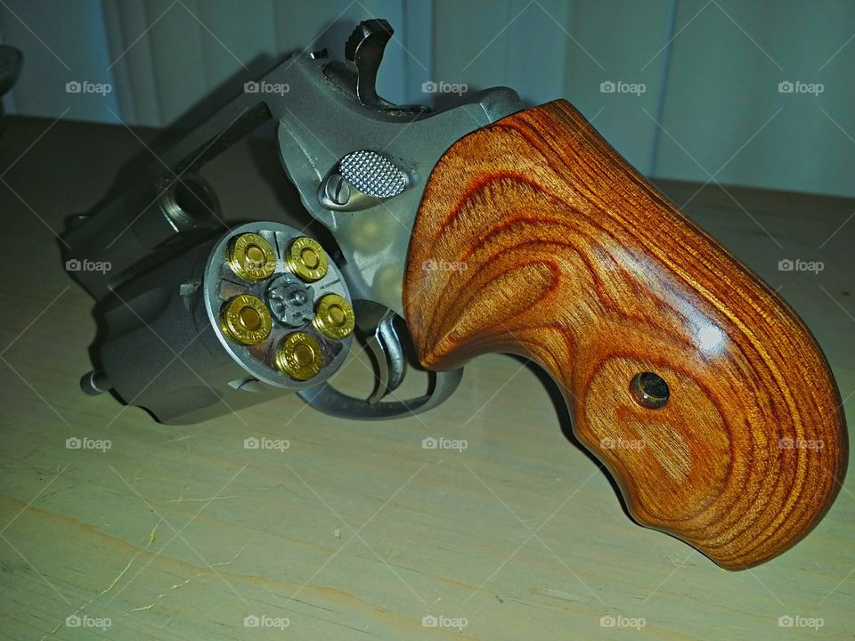 Stainless Steel Revolver. Stainless steel revolver with custom wood grip