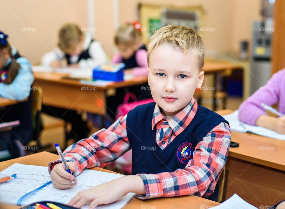 Pupil, school, grade 1, photo of a boy