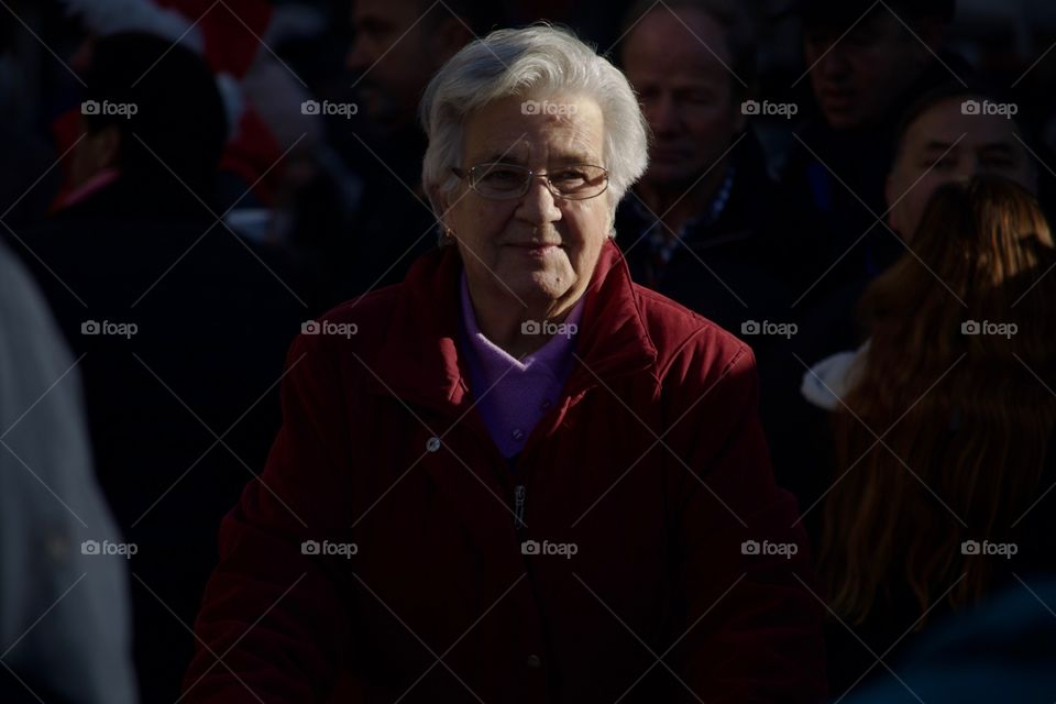 Street Photography.Elderly woman in a crowd.