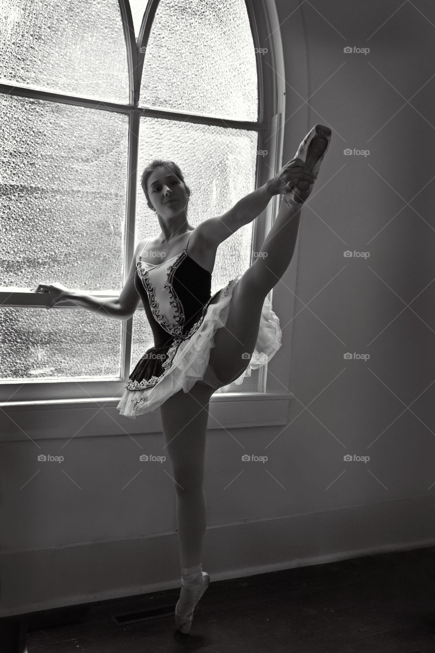 Ballerina pose by the window