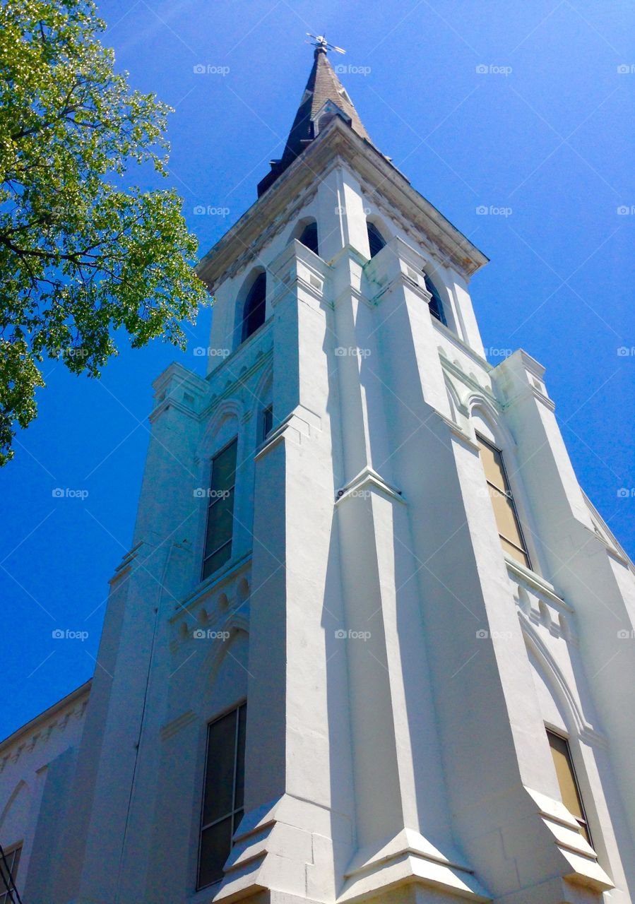 Historic Steeple. The Charleston Emanuel AME Church reaches into a blue summer sky.