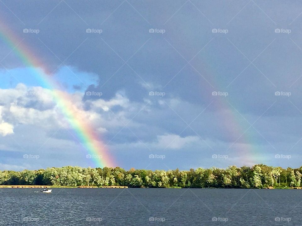 Double rainbow by the lake