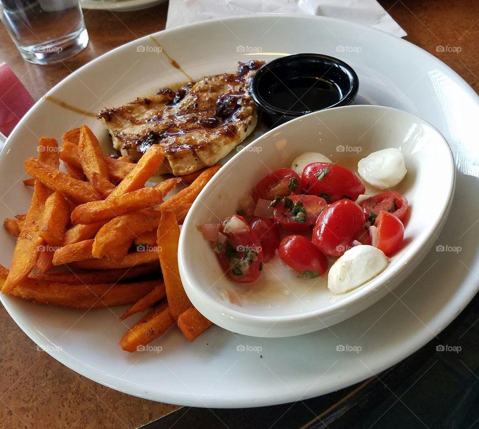 Jack Daniel's chicken with sweet potato fries and tomato and mozzarella salad at TGI Friday's