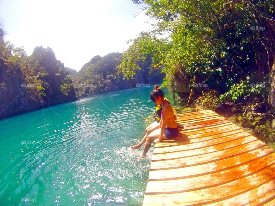 Lady playing with water at Kayangan Lake, Coron Islands, Palawan, Philippines