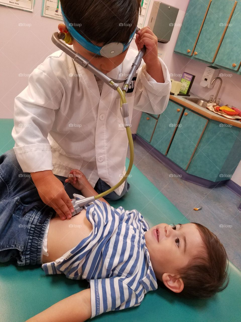 Boy checking patient in clinic