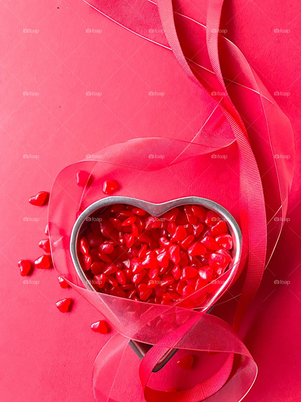 Red heart candy with ribbons