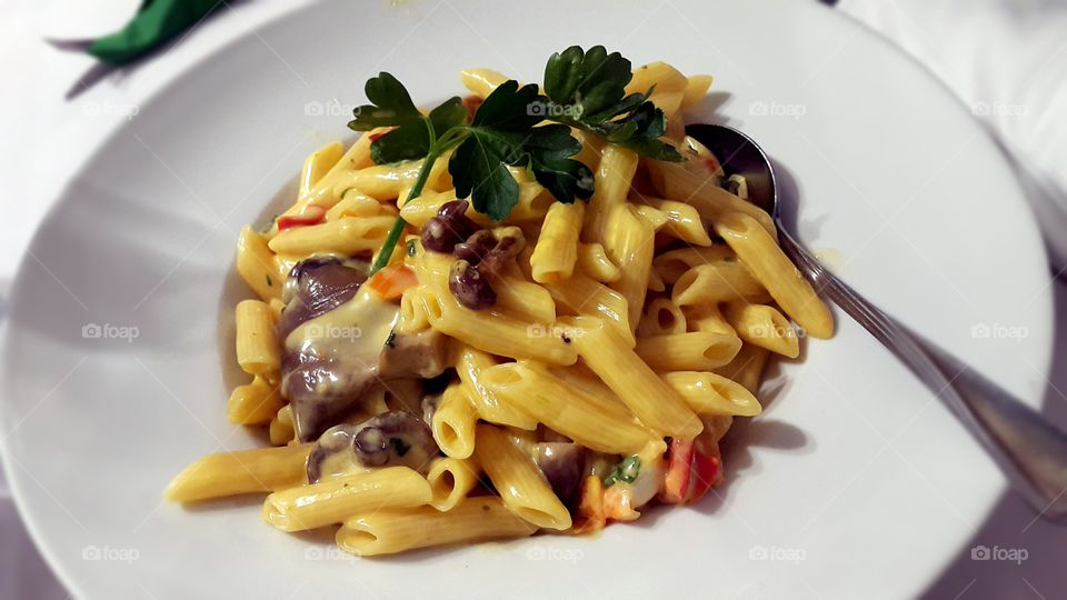 Penne pasta with mushroom in plate