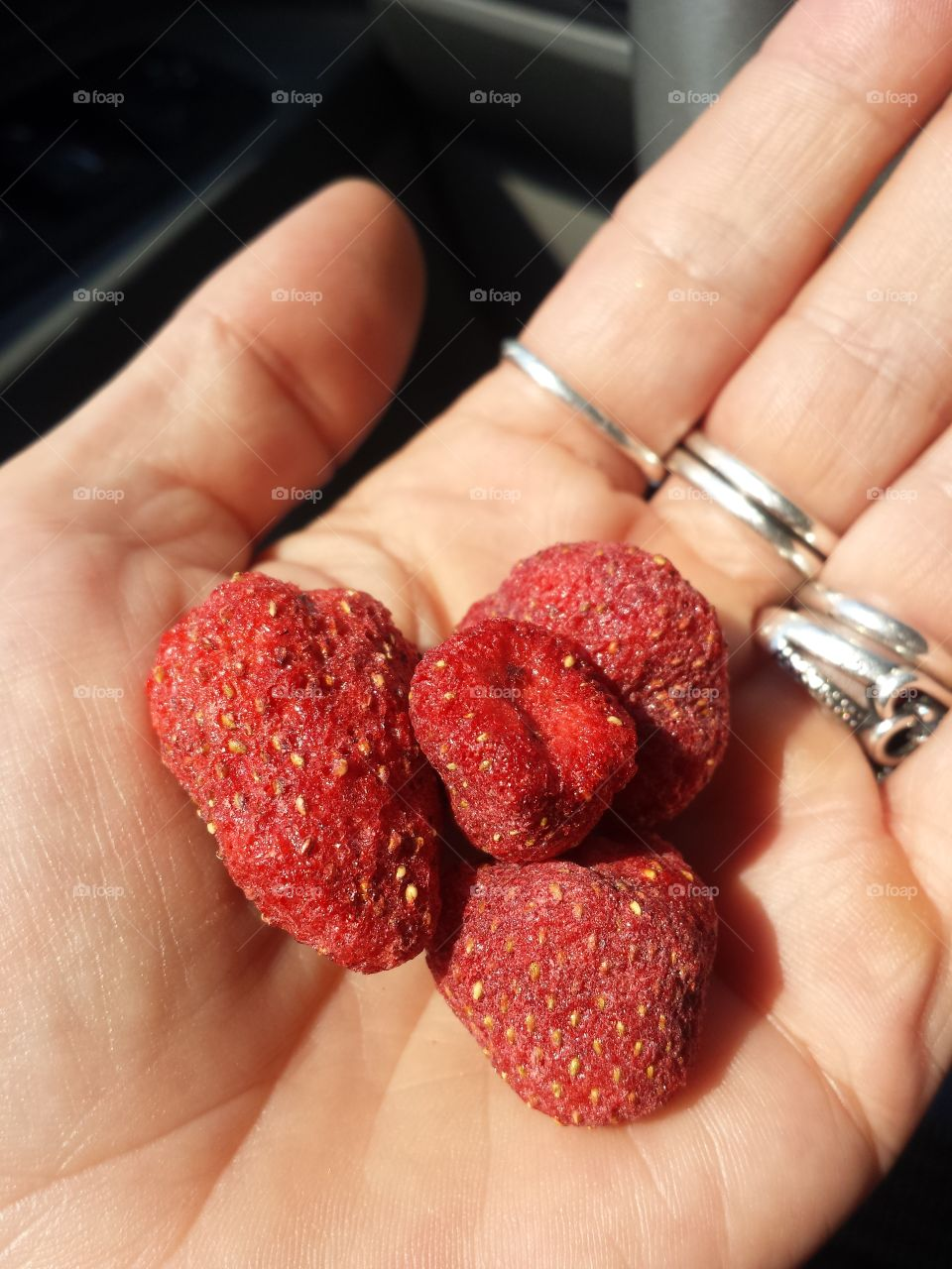 Woman holding strawberries in hand