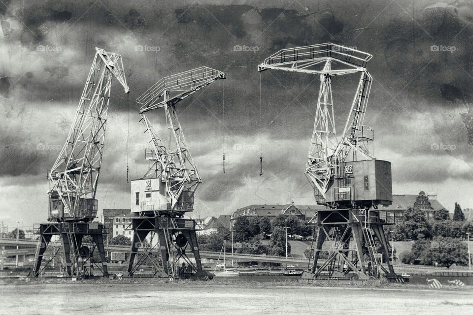 Cranes and small ships in the harbor